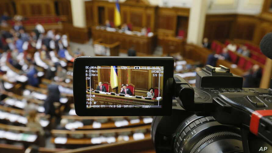 A rostrum of the parliament session hall is seen through a reporter's camera monitor in Kiev, Ukraine, where President Petro Poroshenko recently instructed security officials to strike the names of three BBC journalists off the country's sanctions li