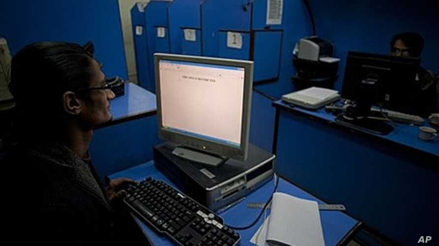 People use the Internet at a cafe in Pakistan where officials want to implement content filters, March 7, 2012.