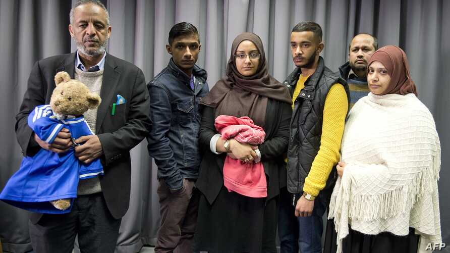FILE - The families of missing British girls Amira Abase and Shamima Begum pose for a picture after being interviewed by the media in central London, Feb. 22, 2015.
