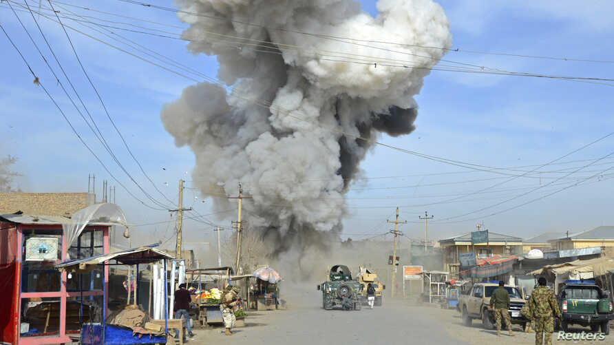 Smoke rises in the sky after a suicide car bomb attack in Kunduz province, February 10, 2015.