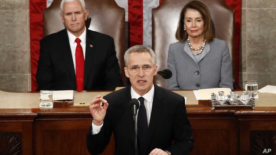NATO Secretary General Jens Stoltenberg, with U.S. Vice President Mike Pence and U.S. House Speaker Nancy Pelosi in the background, addresses a joint meeting of Congress, on Capitol Hill in Washington, April 3, 2019.