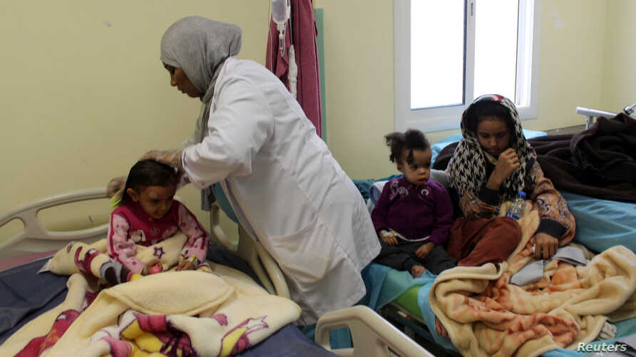 Children, who Libyan forces said left the last cluster of buildings controlled by Islamic State in the group's former stronghold of Sirte, receive medical treatment in a hospital in Misrata, Libya, Dec. 4, 2016. UNICEF says more than 500,000 children...