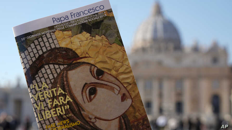 """Pope Francis book on """"Fake News"""", is pictured in front of St. Peter's Basilica, in Rome, Jan. 24, 2018."""