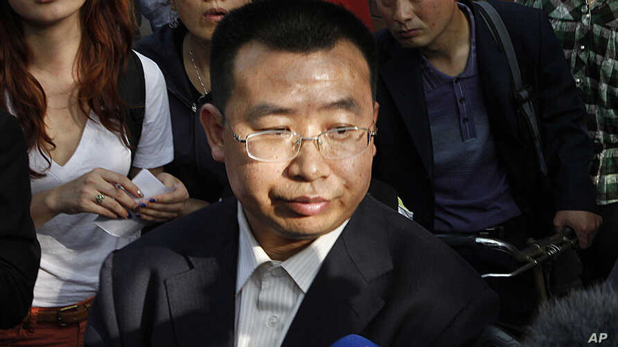 FILE - Human rights activist Jiang Tianyong speaks to journalists in Beijing, China, May 2, 2012. Jiang detained in connection with a sweeping crackdown on lawyers and activists stood trial Aug. 22, 2017, on charges of subversion of state power.