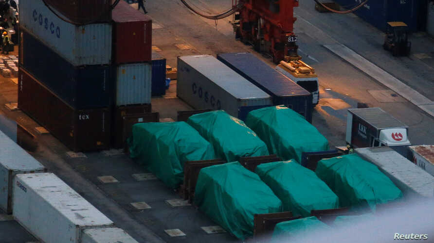 Six of nine armored troop carriers, which belong to Singapore, detained at a container terminal in Hong Kong, Nov. 24, 2016.