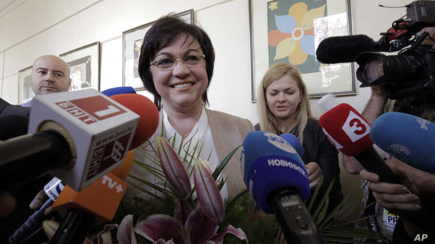 Bulgarian Socialists' Party leader Kornelia Ninova smiles after casting her vote in Sofia, Bulgaria on Sunday, March 26, 2017.