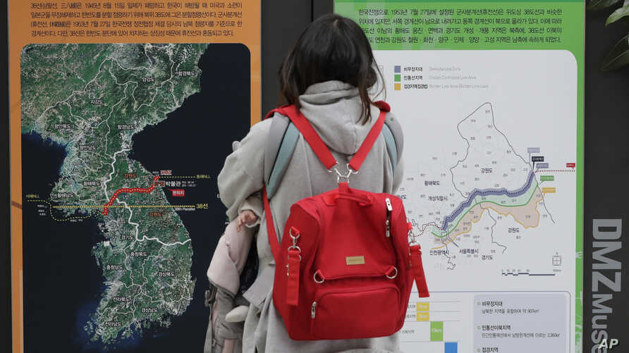 A visitor looks at a map of the Korean peninsula at the DMZ museum inside a restricted area in Goseong, South Korea, Feb. 8, 2019.