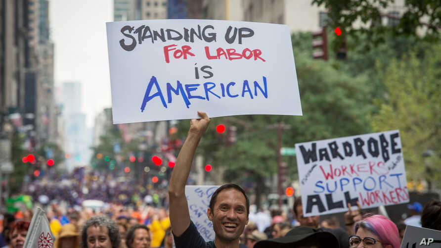 FILE- Local 764 Wardrobe union member Andrae Gonzalo marches in the annual Labor Day Parade in New York.