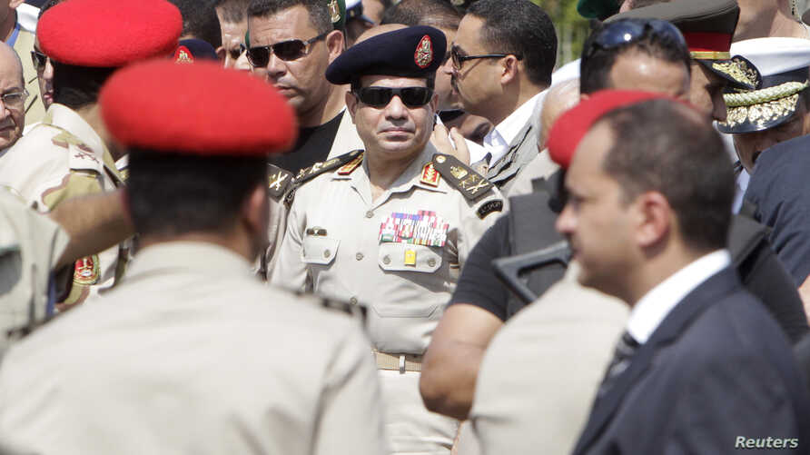 Egyptian Army Chief, General Abdel Fattah al-Sissi (C), is seen in Cairo's Nasr City district in this September 20, 2013, file photo.
