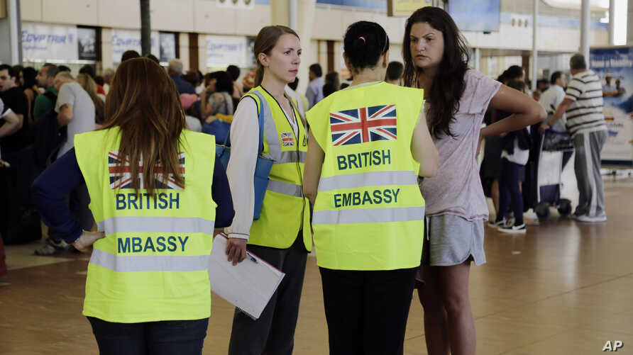 British Embassy staff assist in the evacuation of tourists at the Sharm el-Sheikh International Airport, south Sinai, Egypt, Nov. 6, 2015.