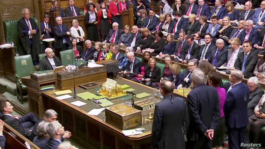 Tellers announce the results of the vote on Brexit alternatives in Parliament in London, March 27, 2019. in this screen grab taken from video.