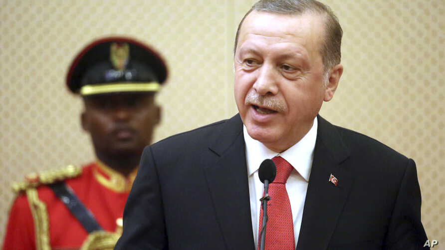 Turkish President Recep Tayyip Erdogan speaks during a joint news conference after his meeting with Tanzania's President John Pombe Magufuli in the commercial capital Dar es Salaam, Tanzania, Monday Jan. 23, 2017.