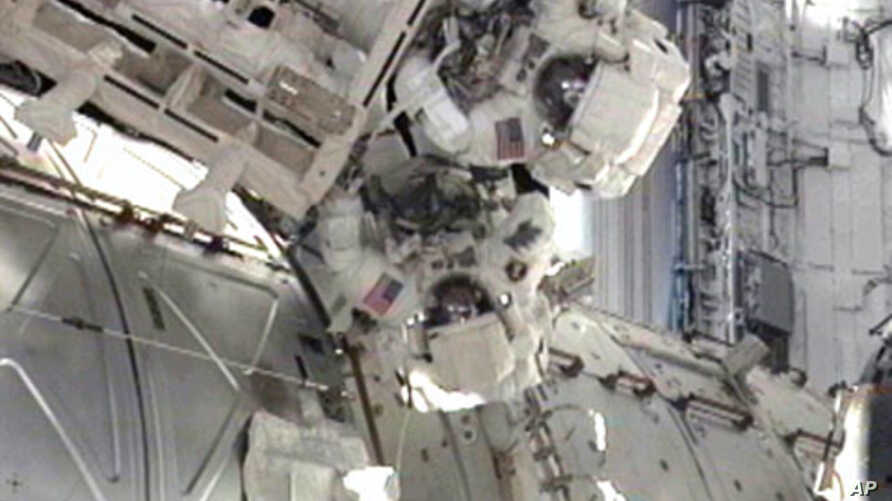 STS-134 Mission Specialists Andrew Feustel and Mike Fincke participate in the mission's third spacewalk as construction and maintenance continue on the International Space Station, May 25, 2011