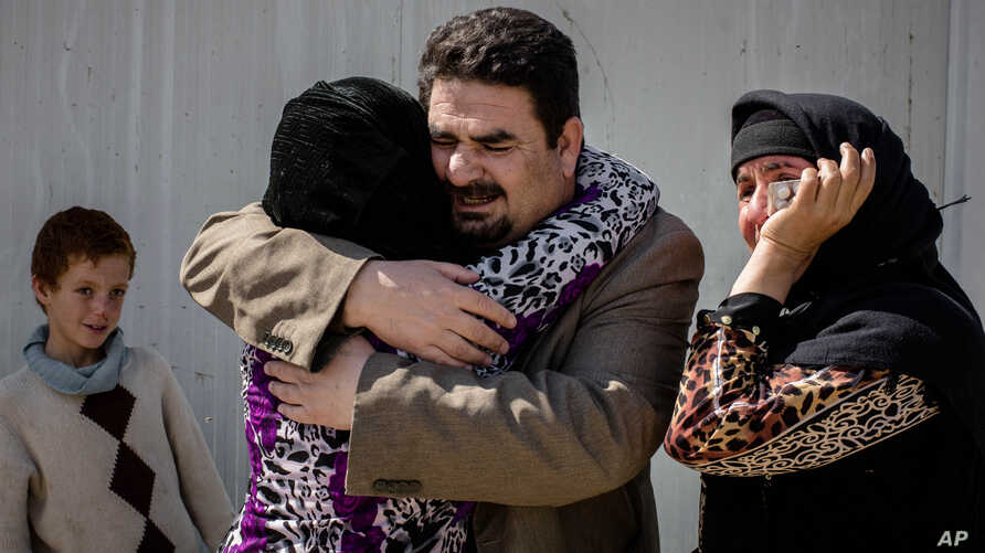 Balkis, 15, embraces her father, Sheikh Matar, March 31, 2016. after being separated from him for over a year. Balkis stayed with her mother, younger sister, and two younger brothers in Islamic State group-controlled territory after her father was fo