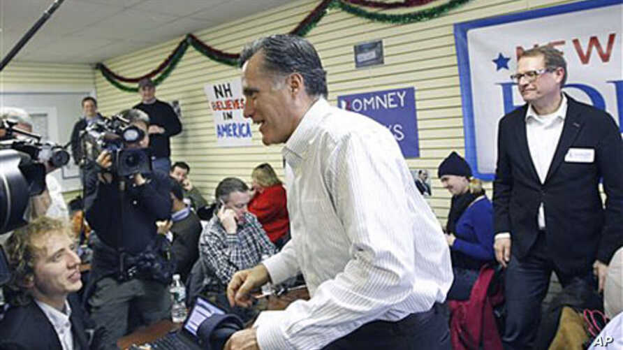 Republican presidential candidate, former Massachusetts Governor Mitt Romney, visits his campaign headquarters in Manchester, New Hampshire, January 9, 2012.