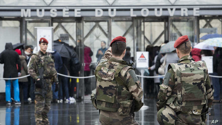 France Louvre AttackFrench soldiers patrol in the courtyard of the Louvre museum with the visitor control in background in Paris, Feb. 4, 2017.  The Louvre in Paris reopened to the public Saturday morning, less than 24-hours after a machete-wielding