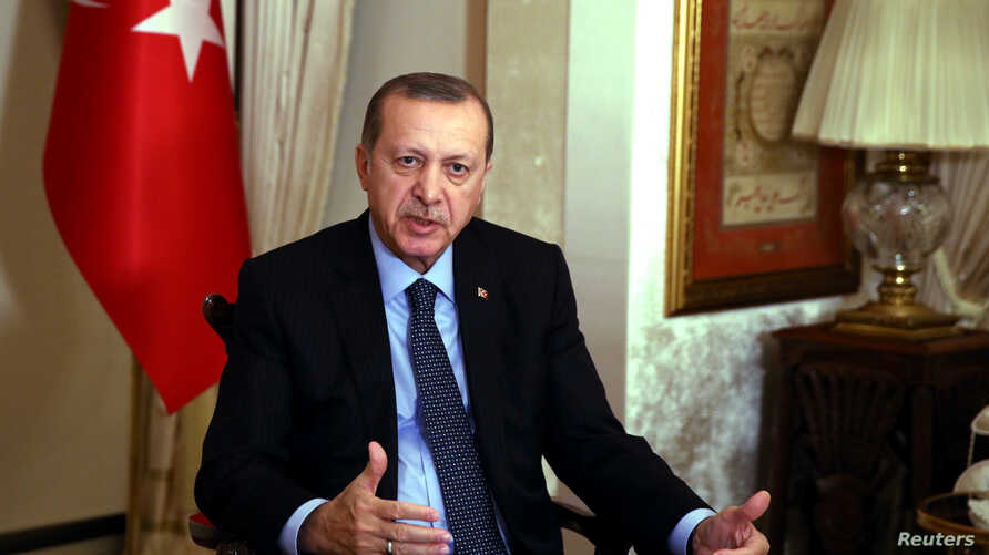 Turkish President Tayyip Erdogan talks during an interview in Istanbul, Monday, Dec. 19, 2016.