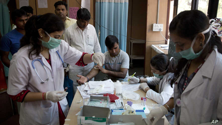 A patient has his blood taken to be tested at a fever clinic especially set up to cater to those suffering from fever, one of the main symptoms of several mosquito-borne diseases such as dengue, at a hospital in New Delhi, India, Sept. 15, 2016. The ...