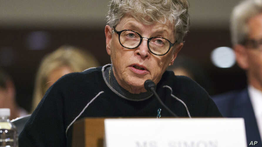 FILE - In this June 5, 2018, photo, former Michigan State President Lou Anna Simon testifies before a Senate subcommittee in Washington. Simon has been charged with lying to police conducting an investigation of Larry Nassar's sexual abuse.