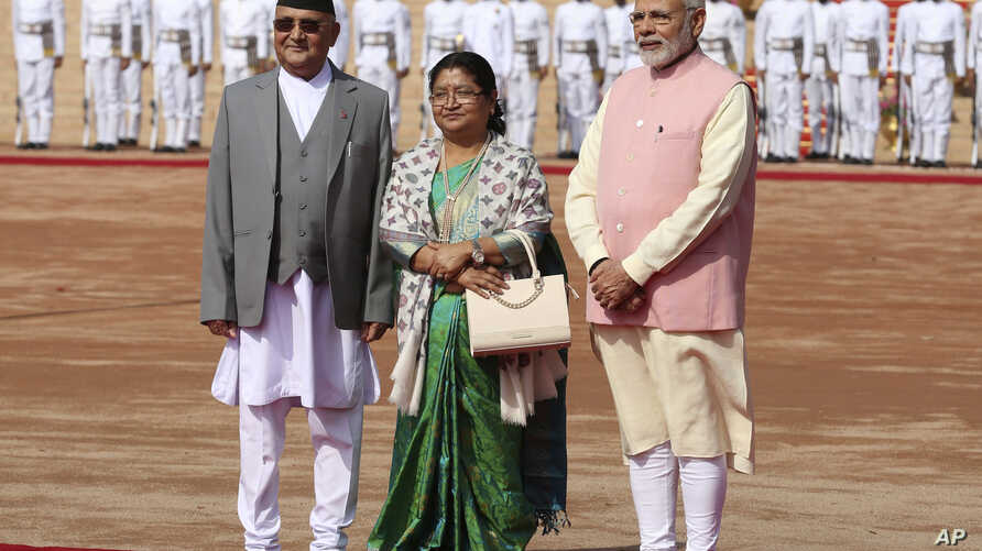 Indian Prime Minister Narendra Modi, right, stands with Nepalese Prime Minister Khadga Prasad Oli and his wife Radhika Shakya during a ceremonial reception for Oli in New Delhi, India, Saturday, April 7, 2018.