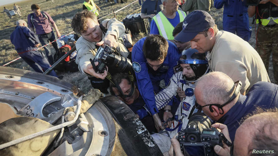 Ground personnel help International Space Station (ISS) crew member Thomas Pesquet of France to get out of a capsule after landing in a remote area outside the town of Dzhezkazgan (Zhezkazgan), Kazakhstan, June 2, 2017.