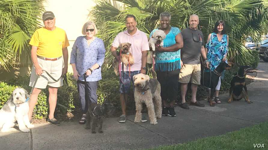 These pet owners and their charges, fleeing from Hurricane Florence, wound up at a Jacksonville, Florida, hotel. (N. Belfiore-Dulay)