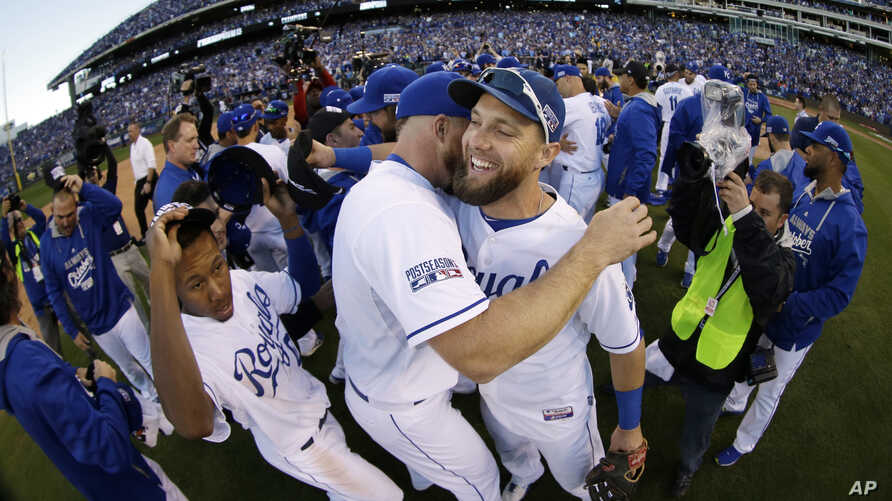 Kansas City Royals' Alex Gordon, right, celebrates with teammates after the Royals defeated the Baltimore Orioles to win the American League baseball championship series Wednesday, Oct. 15, 2014.