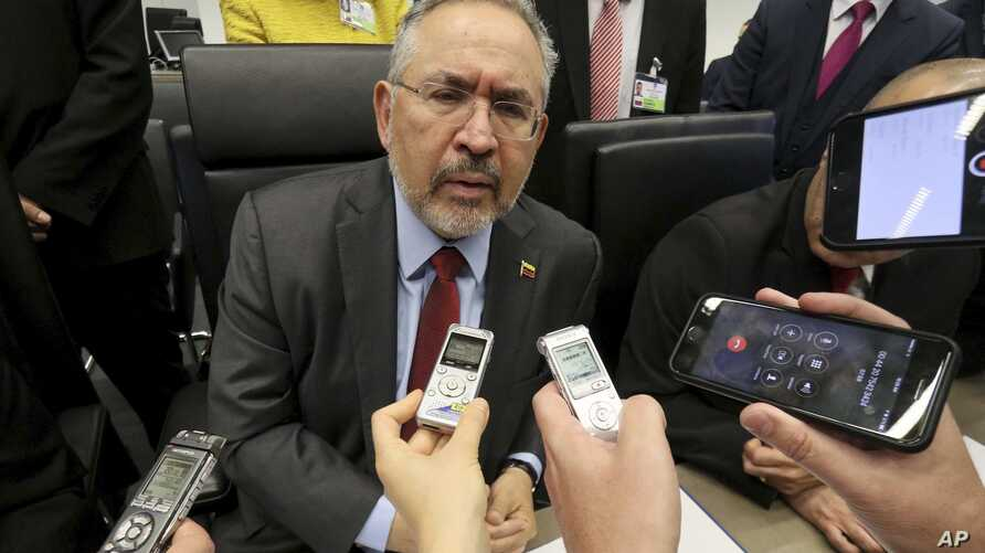 FILE - Nelson P. Martinez, the People's Minister of Petroleum from Venezuela, speaks to journalists before an OPEC meeting in Vienna, Austria, May 25, 2017.