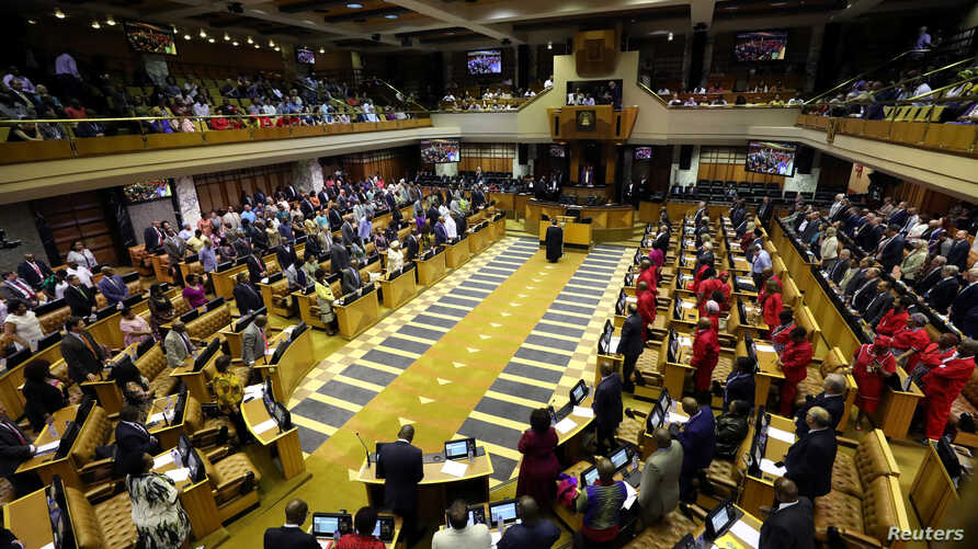 MPs gather in Parliament in Cape Town, South Africa, Feb. 15, 2018.