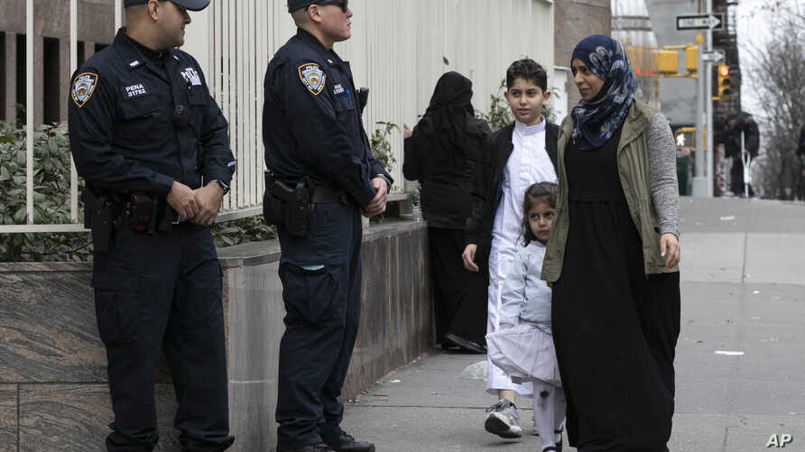 Worshippers arrive for service at the Islamic Cultural Center of New York under increased police security following the shooting in New Zealand, March 15, 2019, in New York.