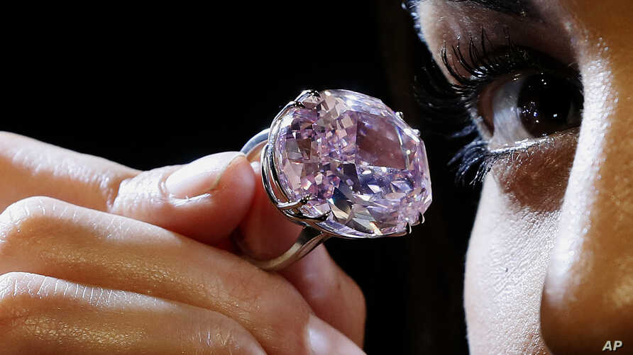 The Pink Star diamond, the most valuable cut diamond ever offered at auction is displayed by a model at Sotheby's auction rooms in London, Monday, March 20, 2017.
