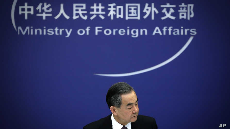 Chinese State Councilor and Foreign Minister Wang Yi reacts during a news conference at the Ministry of Foreign Affairs in Beijing, April 3, 2018.