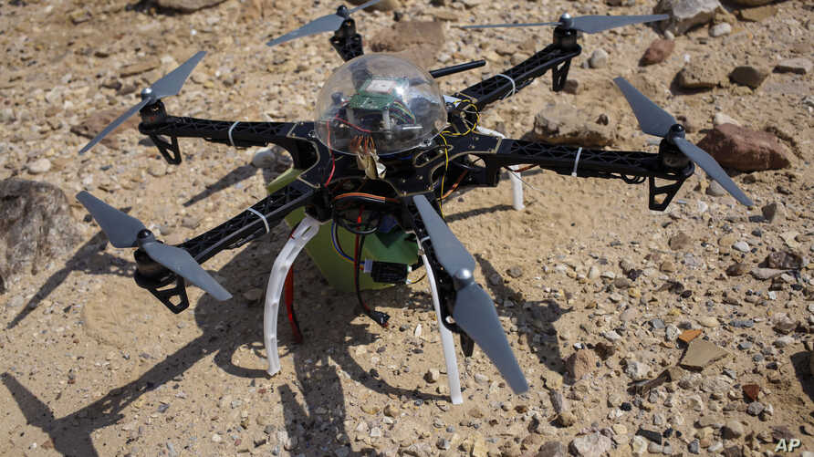 Six-bladed drone casts shadow on a heavily looted 5,000-year-old cemetery, known as Fifa, in southern Jordan, March 19, 2015.