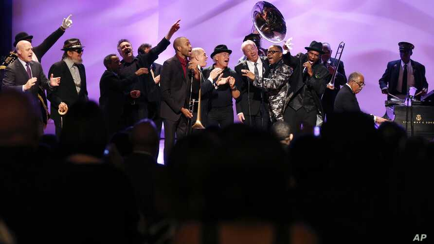 Musicians and speakers sing a grand finale at a tribute for legendary New Orleans composer and recording artist Allen Toussaint, in New Orleans, Louisiana, Nov. 20, 2015.