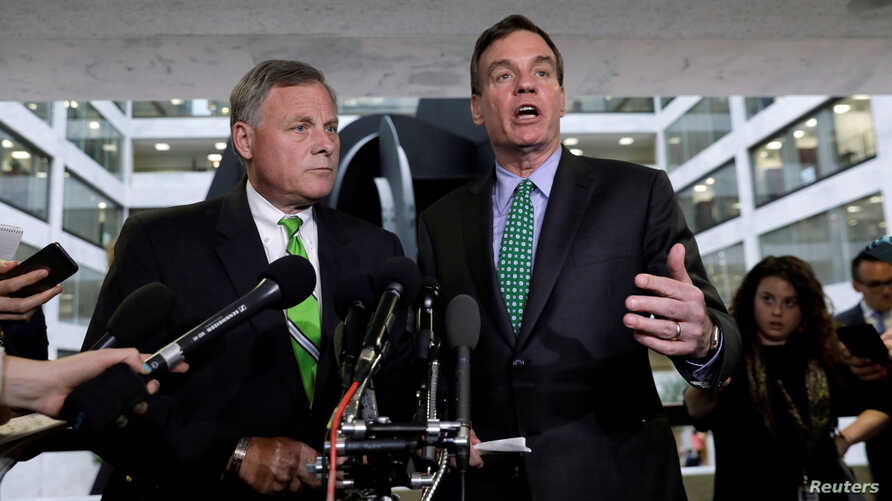 Senate Intelligence Committee Chairman Richard Burr (L) and ranking member Senator Mark Warner (R) speak about former White House national security adviser Michael Flynn following a Senate Select Committee on Intelligence briefing on Capitol Hill in
