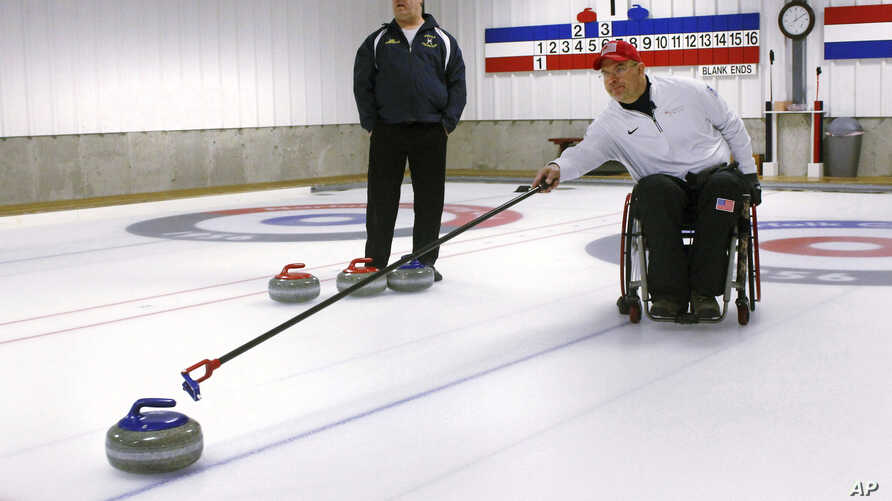 Former Connecticut basketball player Steve Emt practices his curling at the Norfolk Curling Club in Norfolk, Conn., Feb. 21, 2018.