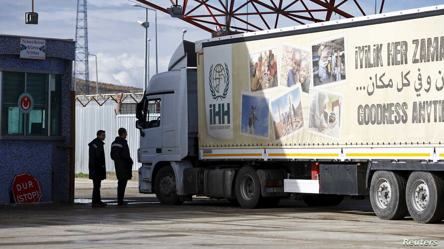 An aid truck enters Syria from Turkey at Turkey's Oncupinar border crossing on the Turkish-Syrian border in the southeastern city of Kilis, Turkey, Feb. 7, 2016.