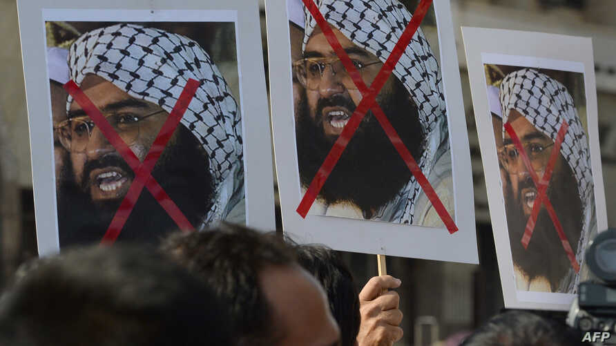 Indian activists carry placards of the leader of the Pakistan-based Jaish-e-Mohammad group, Masood Azhar, during a protest denouncing the attack on the Indian air force base in Pathankot, in Mumbai, India, Jan. 4, 2016.