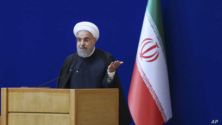 In this photo released by official website of the Iranian Presidency, President Hassan Rouhani speaks during a ceremony marking the country's nuclear energy national day, in Tehran, Iran, Apr. 7, 2016.