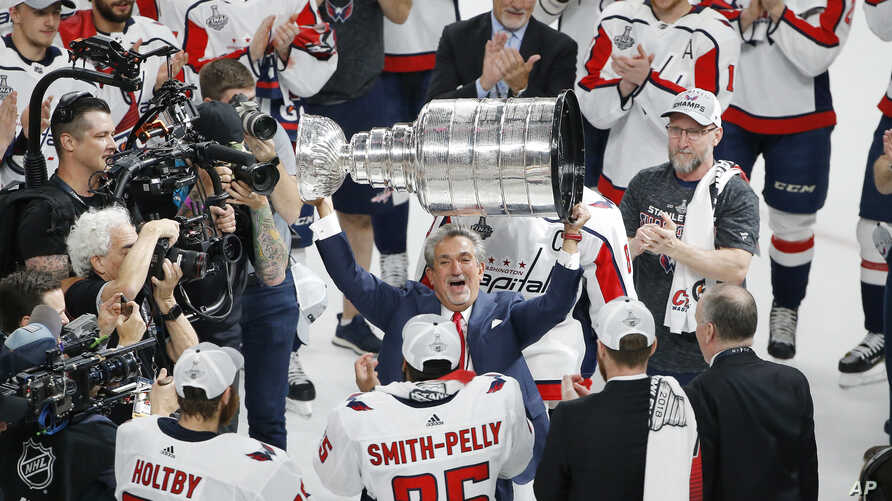 Washington Capitals team owner Ted Leonsis hoists the Stanley Cup after after the Capitals defeated the Golden Knights 4-3 in Game 5 of the NHL hockey Stanley Cup Finals, June 7, 2018, in Las Vegas.