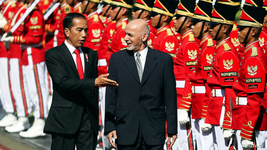 Afghanistan's President Mohammad Ashraf Ghani (R), accompanied by Indonesia's President Joko Widodo, inspects the guard of honor during a welcoming ceremony at the Presidential Palace in Jakarta, Indonesia, April 5, 2017.