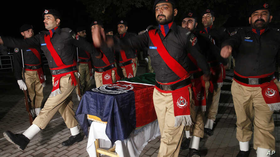 Pakistani police officers attend the funeral of their colleague Tahir Dawar in Peshawar, Pakistan, Nov. 15, 2018.