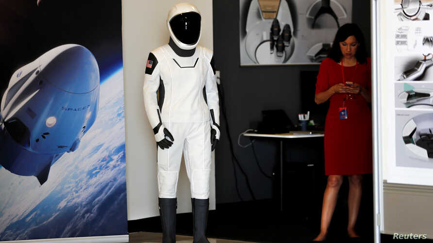 SpaceX shows its new spacesuit that will be worn by NASA astronauts during their first spaceflights in the Crew Dragon spacecraft during a visit to SpaceX headquarters in Hawthorne, California, U.S., Aug. 13, 2018.