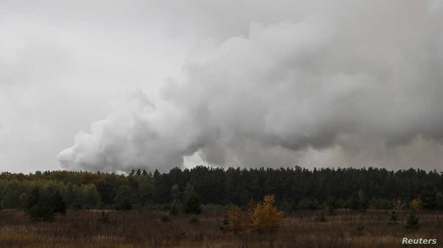 Smoke rises after a fire and explosions hit the Ukrainian defense ministry ammunition depot in the eastern Chernihiv region, Ukraine October 9, 2018.