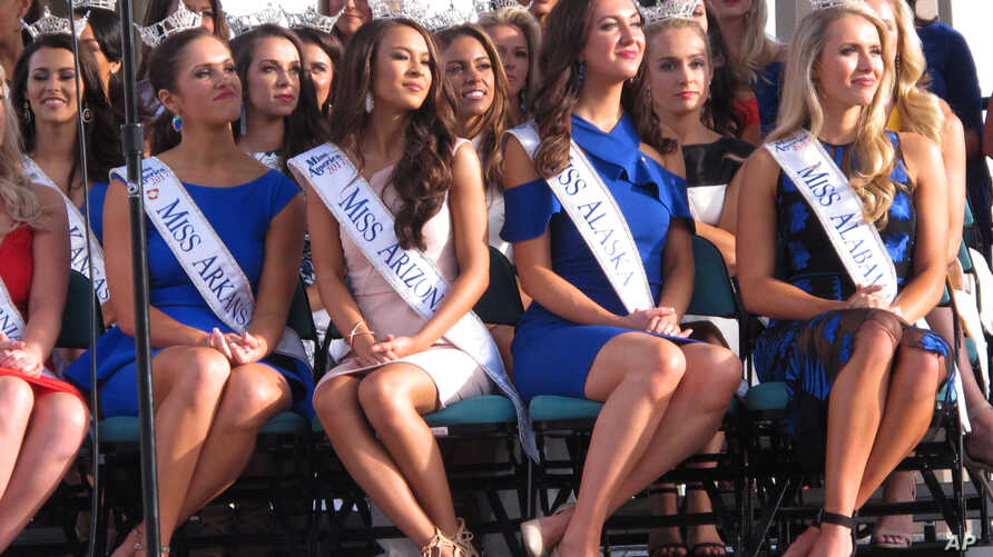 In this Aug. 30, 2017, photo, Miss America contestants sit during a welcoming ceremony in Atlantic City, N.J. The next Miss America will be crowned on Sept. 10.