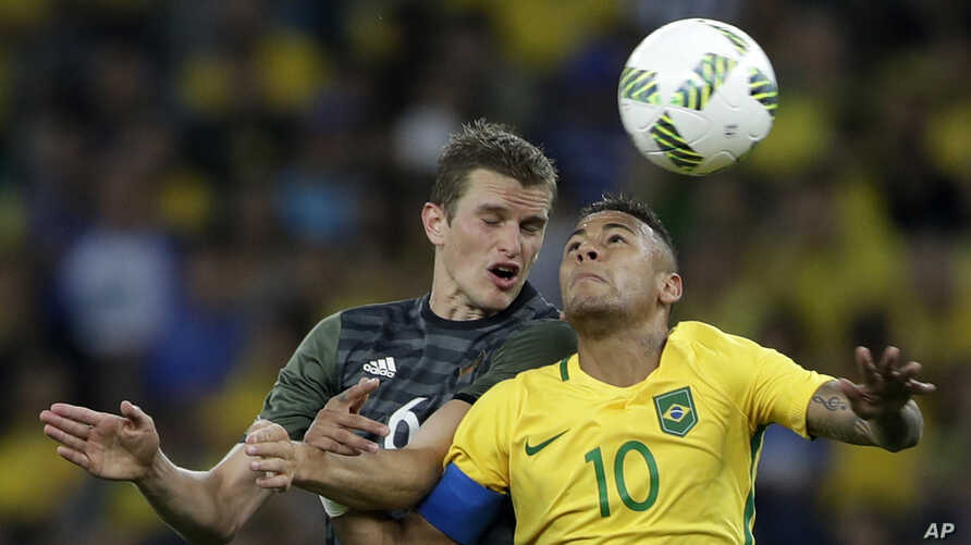 Germany's Sven Bender, left, and Brazil's Neymar go for a header during the final match of the men's Olympic football tournament won by Brazil in Rio de Janeiro, Aug. 20, 2016.