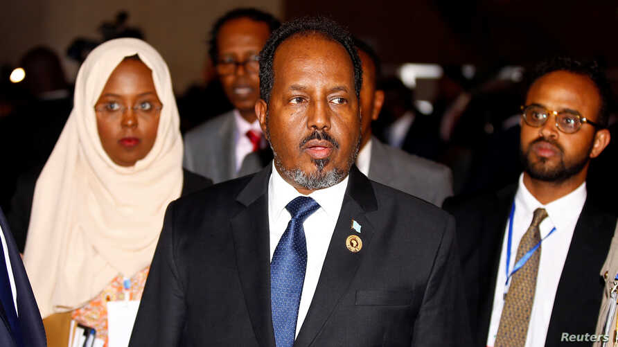 Somali's President Hassan Sheikh Mohamud is escorted as he leaves a meeting of the 28th Ordinary Session of the Assembly of the Heads of State and the Government of the African Union in Ethiopia's capital Addis Ababa, Jan. 30, 2017.