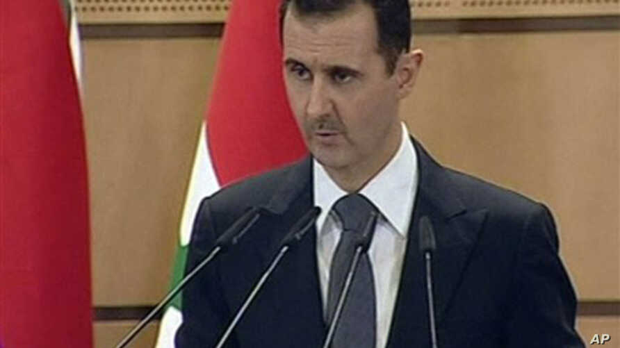 In this screen capture from Syrian TV, Syria's President Bashar Assad delivers a speech in Damascus, June 20, 2011