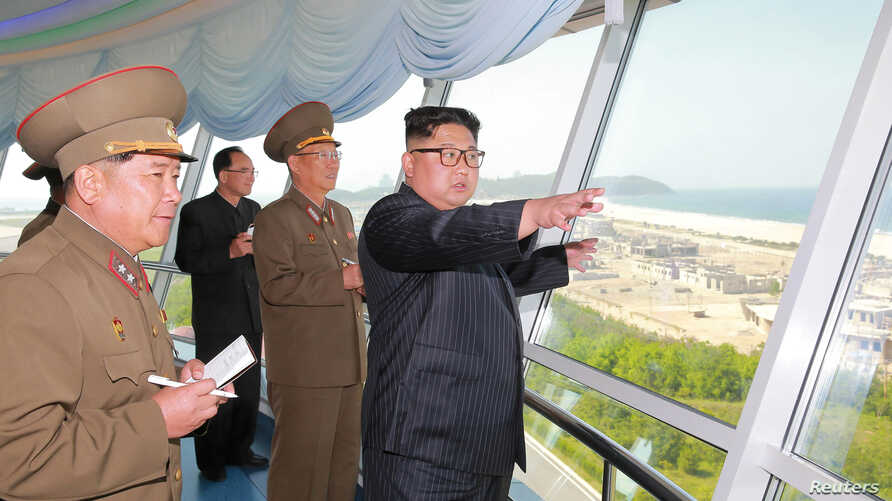FILE - North Korean leader Kim Jong Un inspects the construction site of the Wonsan-Kalma coastal tourist area as Kim Su-gil, third from left, newly appointed director of the General Political Bureau of the Korean People's Army, looks on, in this und