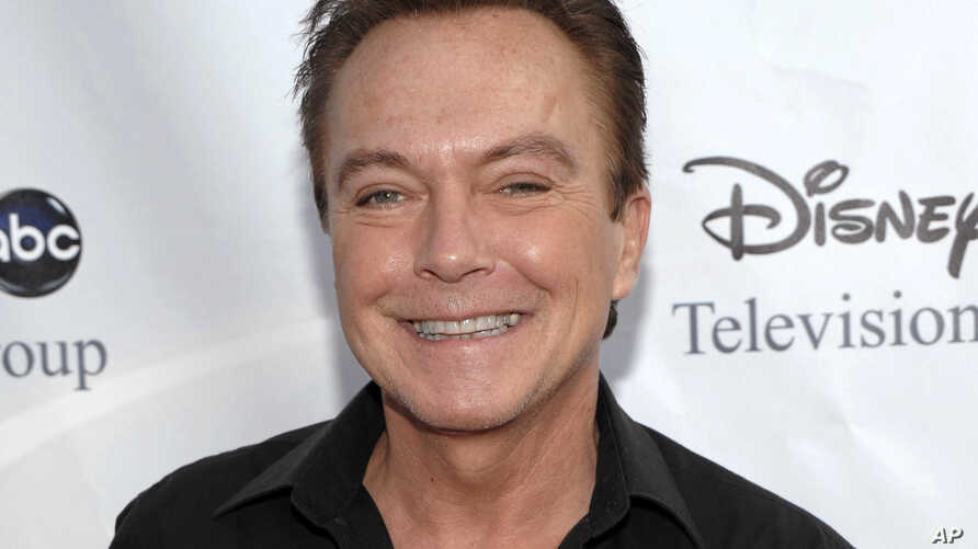 FILE - Actor-singer David Cassidy arrives at the ABC Disney Summer press tour party in Pasadena, Calif., Aug. 8, 2009.